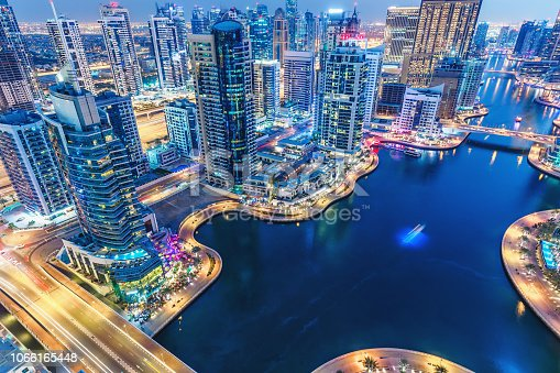istock Aerial view on skyscrapers and highways of Dubai Marina, UAE. Multicolored travel background. 1066165448