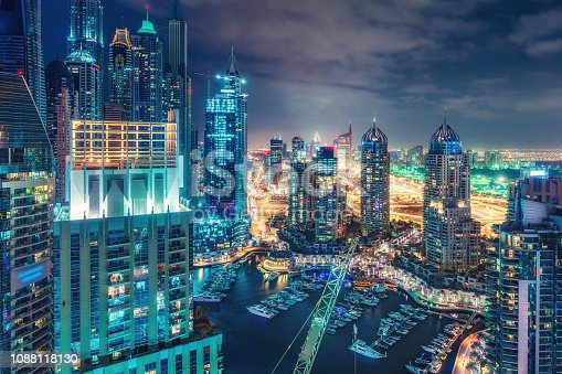 istock Aerial view on skyscrapers and highways of Dubai Marina, UAE. Multicolored travel background. 1088118130