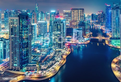 istock Aerial view on skyscrapers and highways of Dubai Marina, UAE. Multicolored travel background. 1088118140