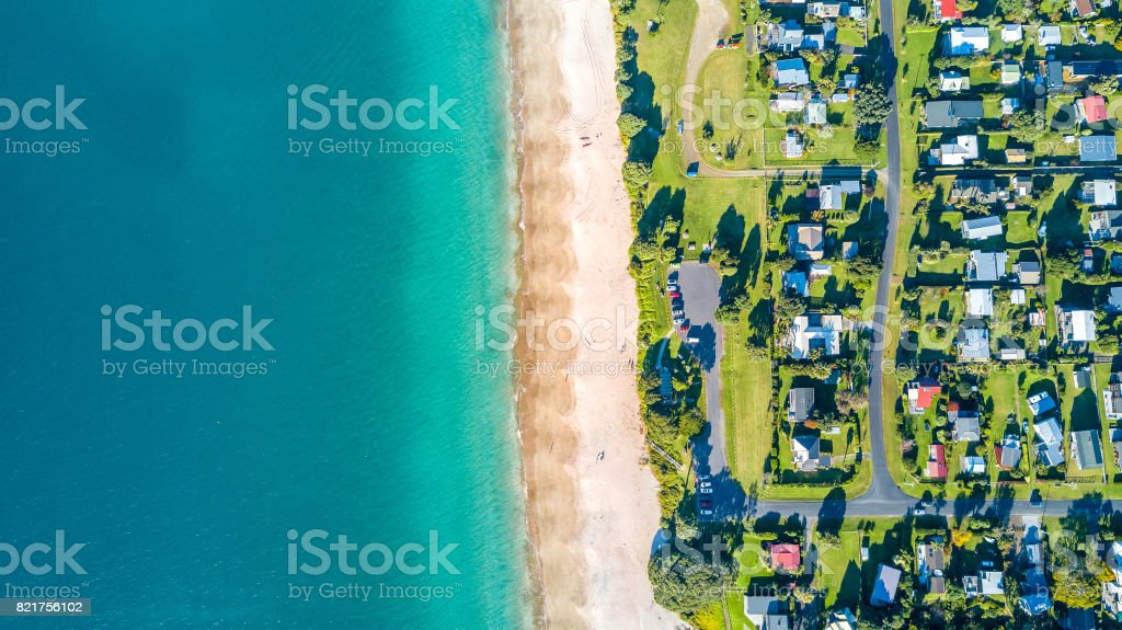 Aerial view on small suburb on a sunny ocean beach. Coromandel peninsula, New Zealand stock photo