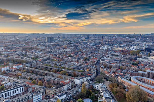 aerial view on the hague's city centre at dusk - den haag stockfoto's en -beelden
