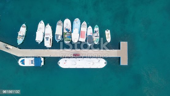 1066331604 istock photo Aerial view on the harbor with boats and yachts. Beautiful composition with sea transport 961561132