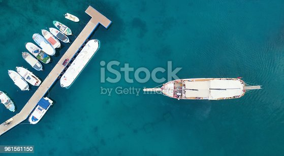 1066331604 istock photo Aerial view on the harbor with boats and yachts. Beautiful composition with sea transport 961561150