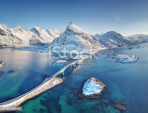 istock Aerial view on the Lofoten islands, Norway. Natural landscape from drone. Bridge adove islands. Aerial landscape from air in the Norway. Norway-image 1125289491
