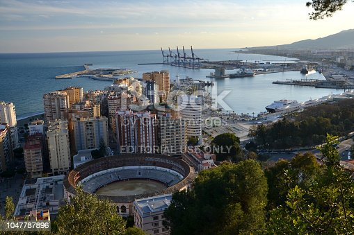 Malaga, Spain - 26 February, 2013: Aerial view on the Malaga city in the sunset. On the first plan we see the bullring. It is a historical arena where bullfighting is performed.