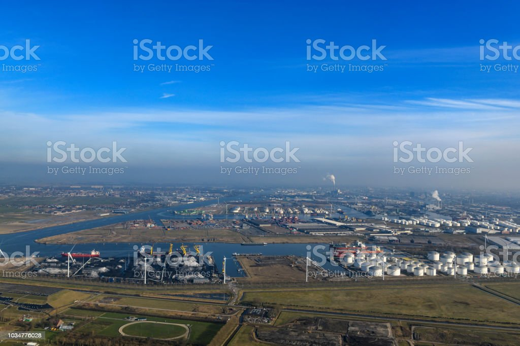 Aerial View On The The Port Of Amsterdam With Oil And Coal