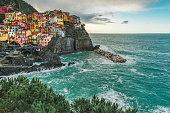 istock Aerial view on village of Manarola, on the Cinque Terre coast of Italy, Liguria 1211851052