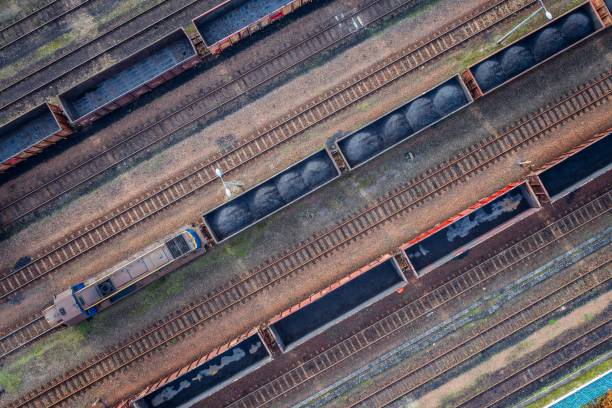 aerial view on wagons with black coal. - rail stock photos and pictures