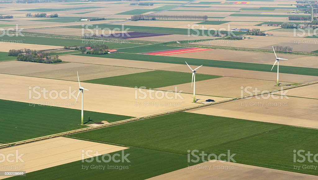 Aerial view on wind turbines in the fields stock photo