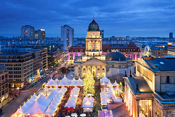 Aerial view onto Christmas market at Gendarmenmarkt square in Berlin Dusk view on a Christmas market at the end of December, taken from the top of the French Cathedral gendarmenmarkt stock pictures, royalty-free photos & images