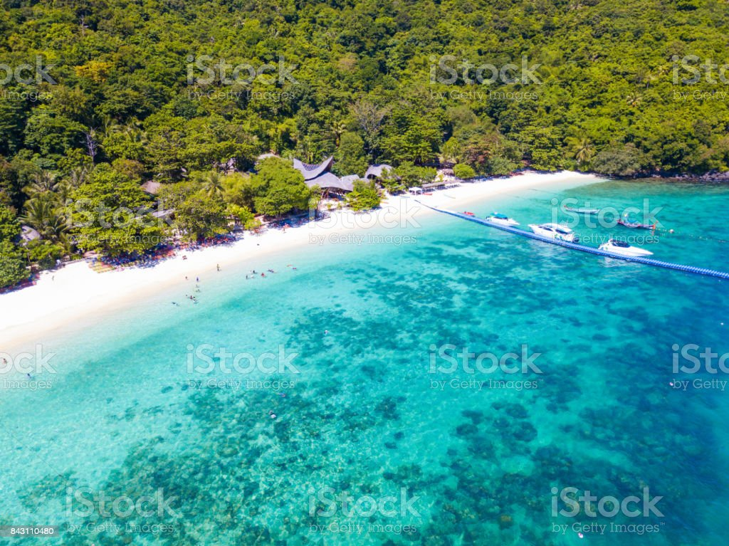 Aerial view or top view of tropical island beach with clear water stock photo