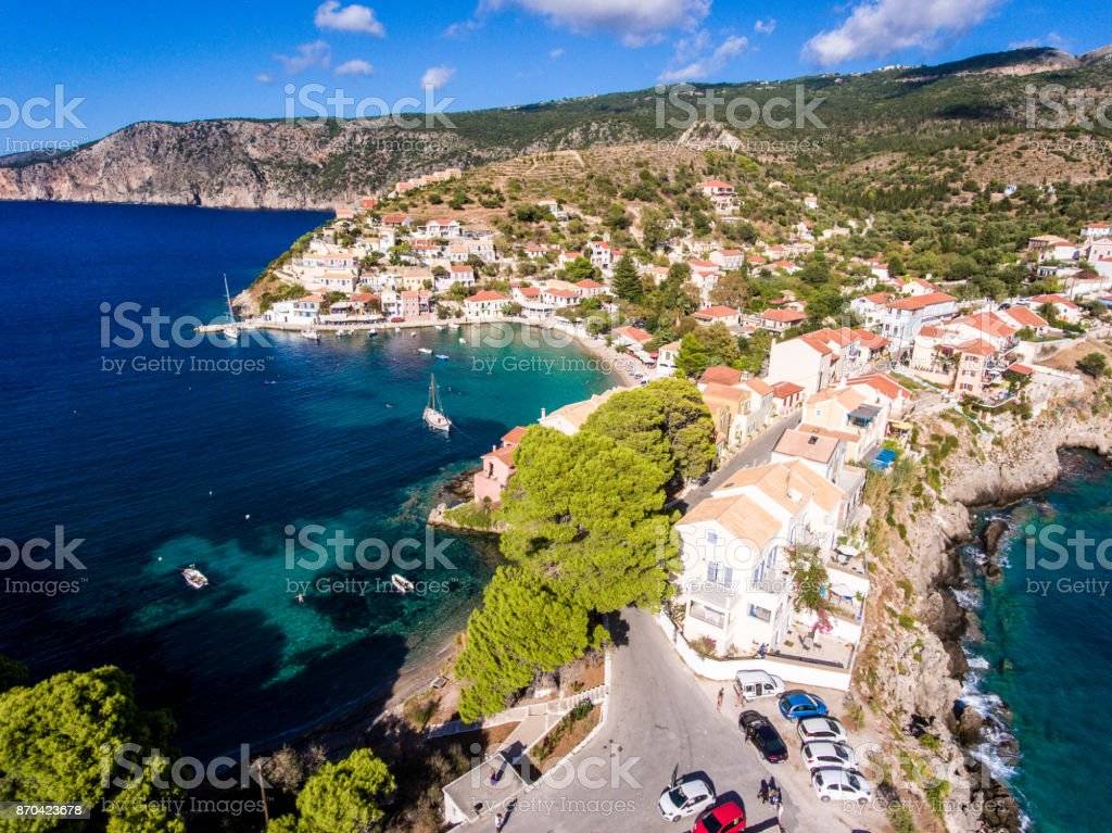 Aerial view over Assos Kefalonia beach with clear blue waters and yachts in harbour stock photo