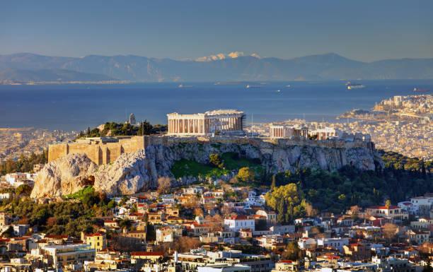 撮テとアテネのアクロポリスとリカベトスの丘から港の丘、日の出ギリシャ - アテネ ストックフォトと画像