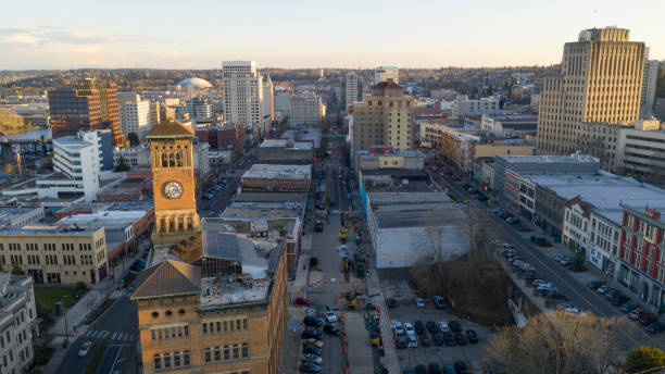 Aerial View Over Downtown Tacoma Washington Broadway Market Streets The Sun is low in the sky late afternoon over the urban city skyline of Tacoma Washington pierce county washington state stock pictures, royalty-free photos & images