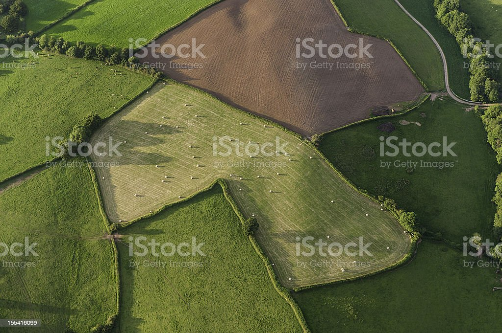 Aerial view over farm fields crops and hedgerows royalty-free stock photo