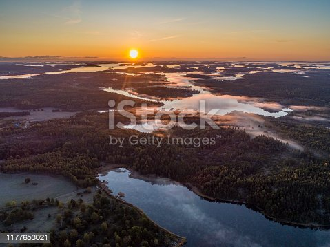Aerial view over foggy lake in Sweden