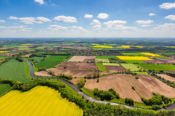 Aerial view over Germany patchwork farmland Aerial view of agricultural land in Germany. Near by Celle, in Lower Saxony, Germany. lower saxony stock pictures, royalty-free photos & images