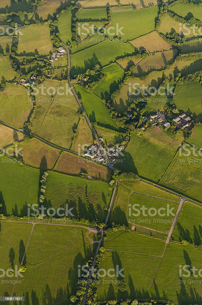 Aerial view over green field farms villages summer pasture royalty-free stock photo