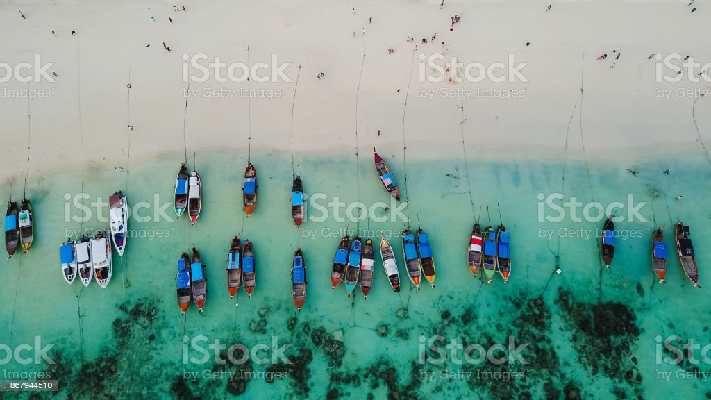 Aerial view over group of long tail boats with beautiful sea and beach,Top view from drone, Koh Lipe island, Satun,Thailand. stock photo
