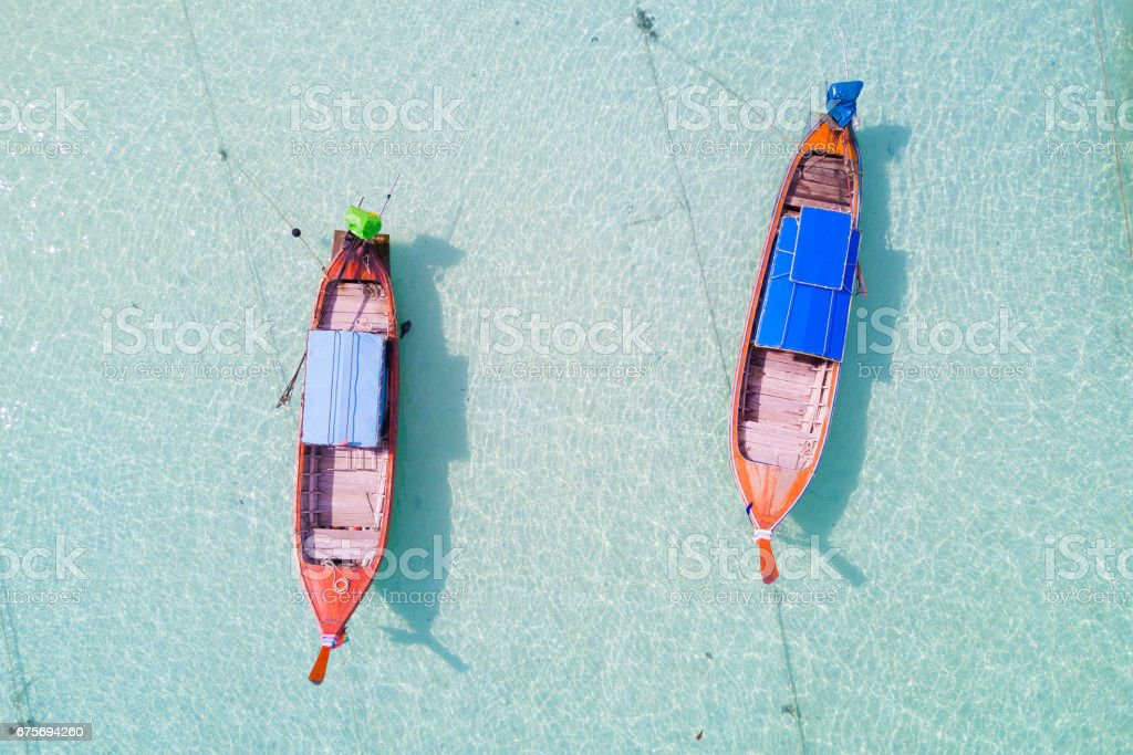 Aerial view over group of long tail boats,Top view from drone, Koh Lipe island, Satun,Thailand. stock photo