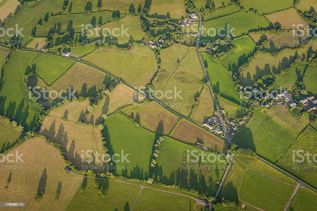 Aerial view over idyllic rural landscape patchwork fields royalty-free stock photo