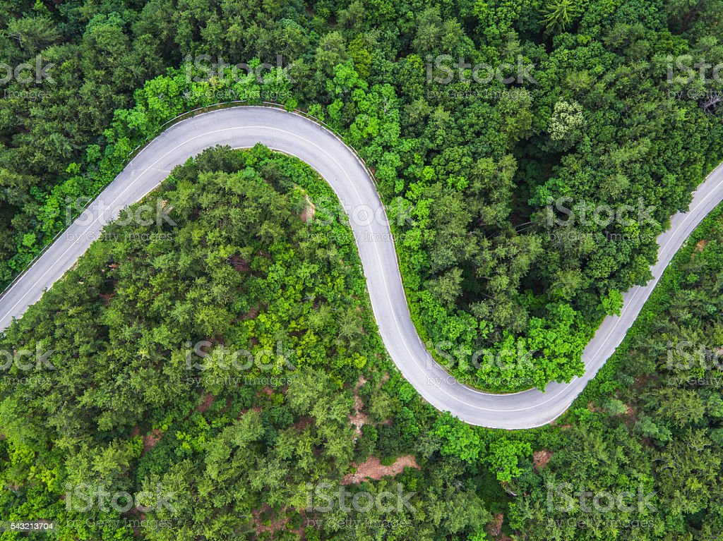 Aerial view over mountain road stock photo
