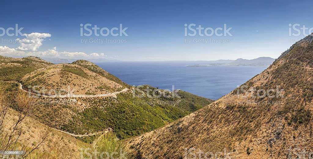 Aerial view over mountains to the rural road stock photo