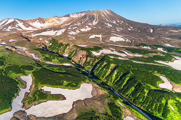 Aerial View over Mutnovsky Volcano Aerial View over Mutnovsky Volcano kamchatka peninsula stock pictures, royalty-free photos & images