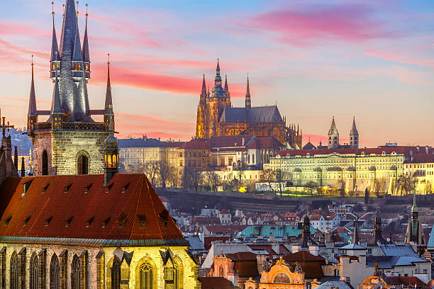 Aerial view over Old Town at sunset, Prague Aerial view over Church of Our Lady before Tyn, Old Town and Prague Castle at sunset in Prague, Czech Republic  tyn church stock pictures, royalty-free photos & images