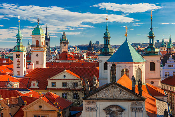 Aerial view over Old Town in Prague, Czech Republic Aerial view over Old Town in Prague with domes of churches, Bell tower of the Old Town Hall, Powder Tower, Czech Republic  tyn church stock pictures, royalty-free photos & images