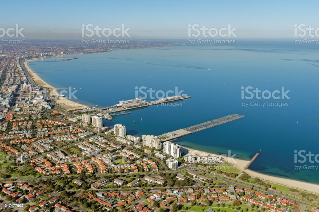 Aerial view over Port Melbourne, Victoria, Australia towards Port Phillip Bay stock photo