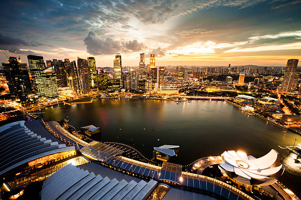 aerial view over singapore marina bay - singapore stock photos and pictures