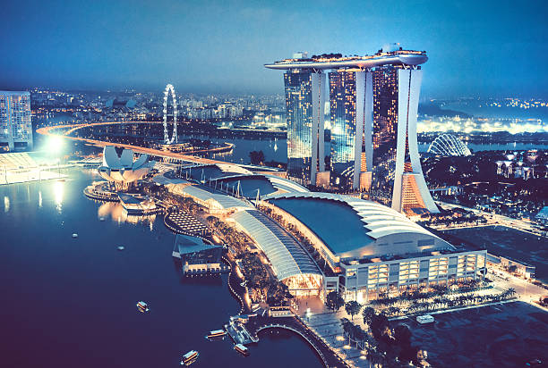 aerial view over singapore  with marina bay sands hotel, singapore - singapour photos et images de collection