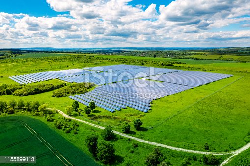 Aerial view over Solar cells energy farm in countryside landscape