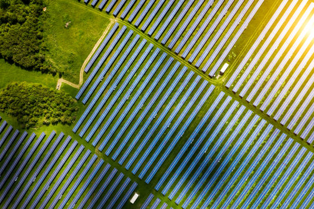 Aerial view over Solar cells energy farm in countryside landscape stock photo
