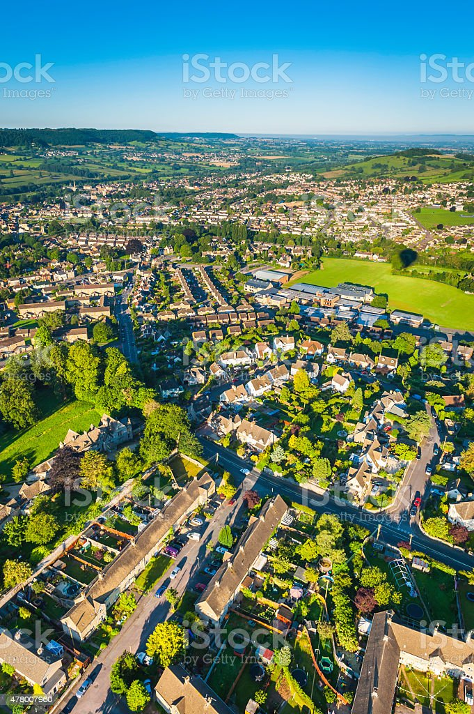 Aerial view over suburban family homes green gardens country town stock photo