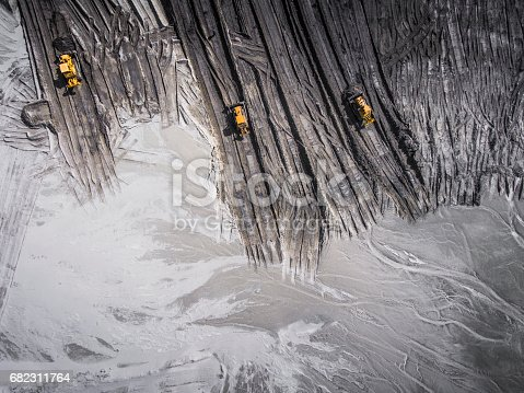 istock Aerial view over the building materials processing factory. Sand mine. View from above. 682311764