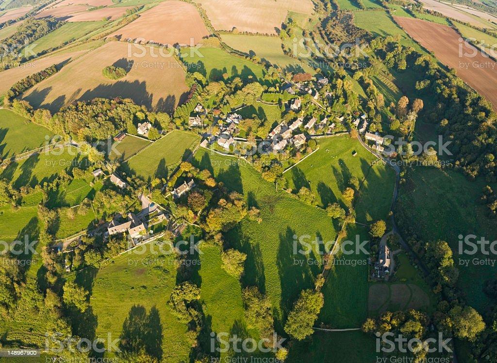 Aerial view over village farm pasture stock photo