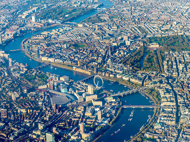 aerial view over westminster and river thames, london, england, uk - theems stockfoto's en -beelden