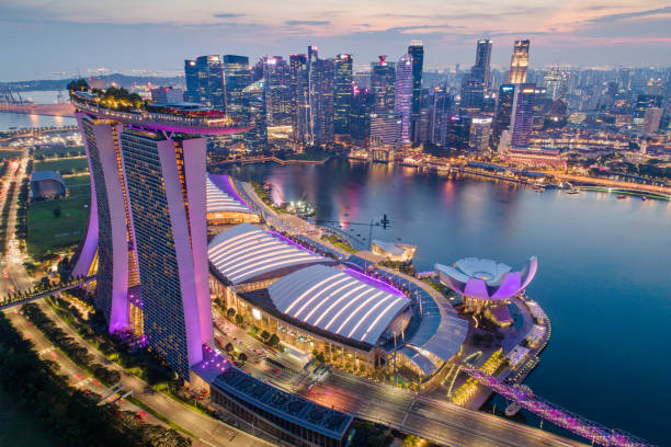 aerial view panoramic of the singapore skyline and marina bay, the marina is the centre of the economy in singapore, there are here all the building in singapore central - marina bay sands stock photos and pictures