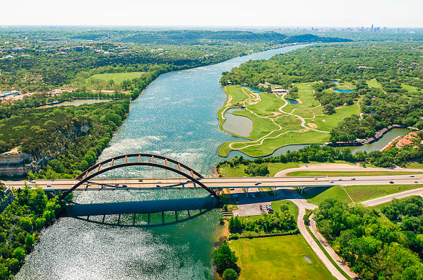 Aerial view Pennybacker 360 bridge on Colorado River, Austin, Texas Aerial view from helicopter of 360 bridge on Colorado River near Austin Texas. colorado river stock pictures, royalty-free photos & images