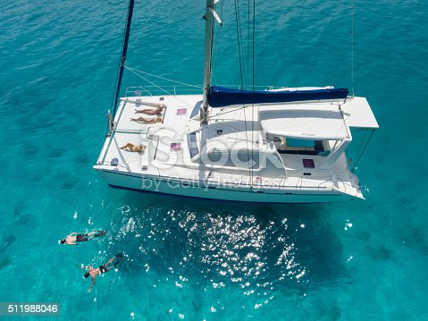 544966382istockphoto Aerial view people relaxing on catamaran anchored in tropical water 511988046