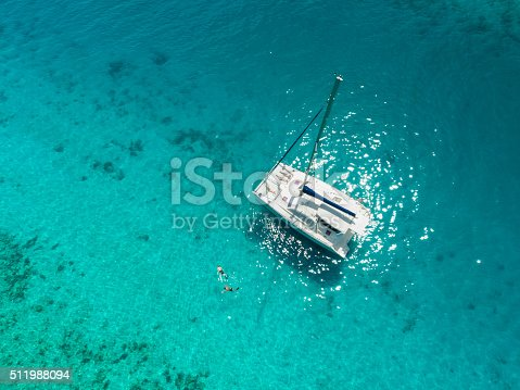 544966382istockphoto Aerial view people relaxing on catamaran anchored in tropical water 511988094