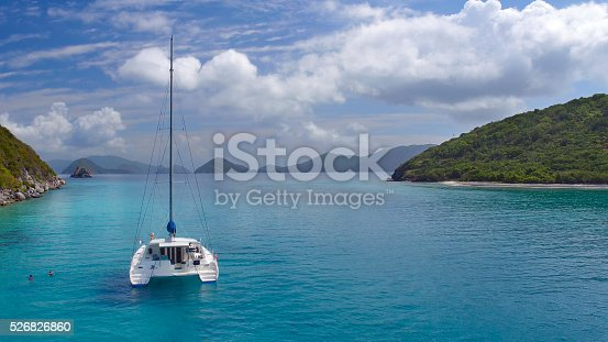 544966382istockphoto Aerial view People relaxing on Catamaran anchored in tropical water 526826860