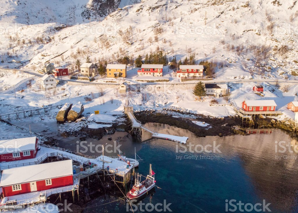 Aerial view red hut fishing village on coastline in winter stock photo