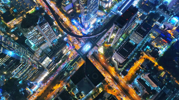 Aerial view Road roundabout, Expressway with car lots in the city in Thailand. Top view of traffic on freeway. Beautiful street background at downtown Bangkok. stock photo