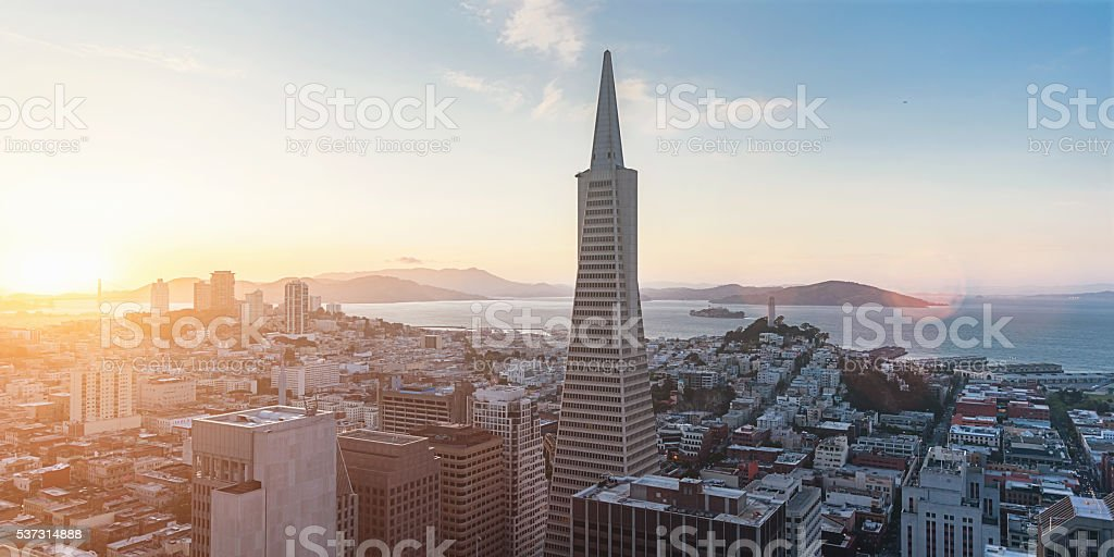 Aerial View San Francisco Skyline Sunset Panorama San Francisco cityscape aerial view overlooking the financial district during a beautiful sunset twilight. Golden Gate Bridge, Alcatraz and Coit Tower on the background horizon. San Francisco, Financial District, California, USA. Aerial View Stock Photo