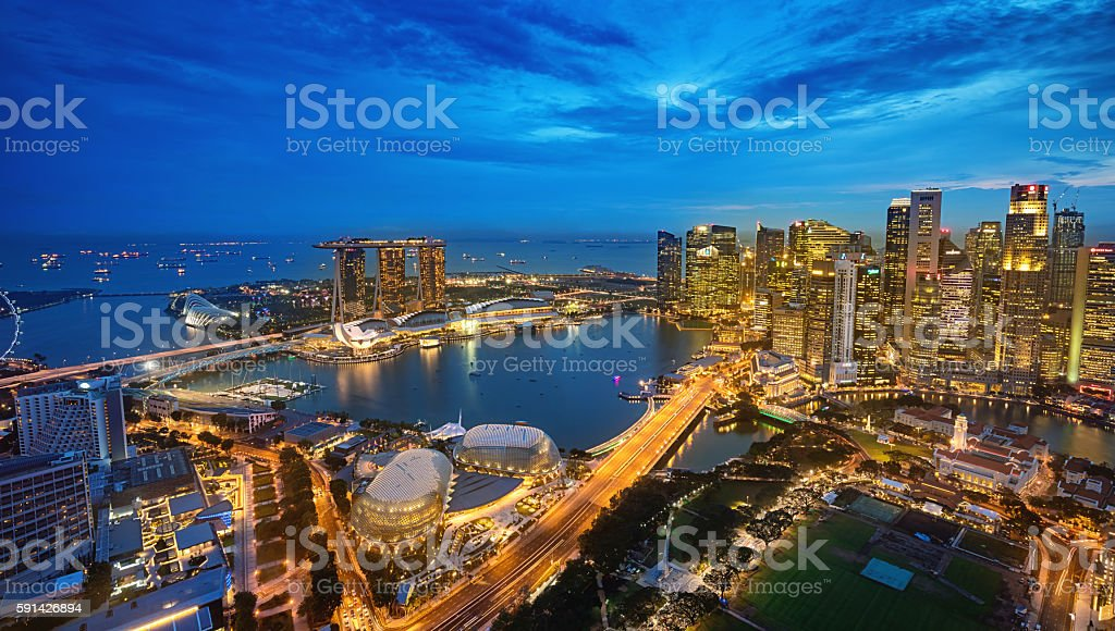 Aerial View Singapore Marina Bay at Dusk Aerial view over downtown singapore at Dusk towards the modern Business District Skyscrapers over The Singapore City Hall, the National Gallery of Singapore, Padang Singapore and the Singapore Cricket Club, Marina Bay and Marina Bay Sands Hotel in the background. Singapore City, Downtown - Marina Bay  District, Asia. XXXL Photo, made with Sony A7RII. Aerial View Stock Photo