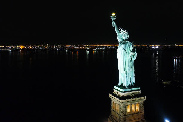 Aerial View Statue of Liberty at Night stock photo