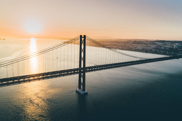 Aerial view suspension bridge over Tagus river in Lisbon. stock photo